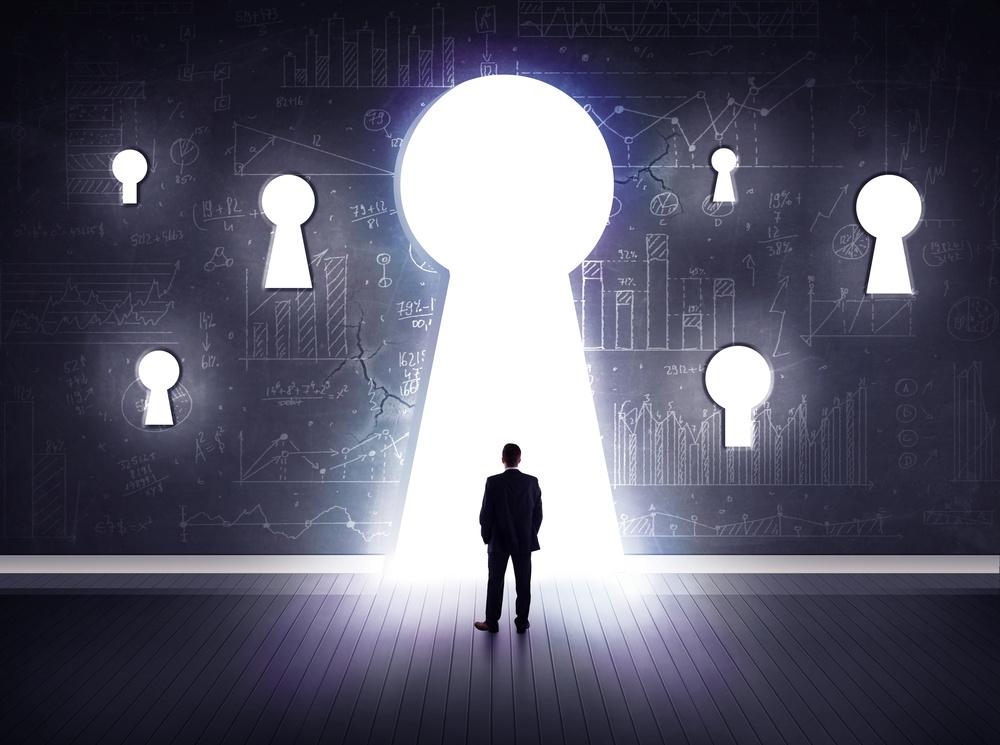 Successful businessman looking through keyhole-1